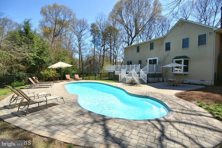 HOT NEW SEVERNA PARK LISTING! Vacation at home w/your very own outdoor paradise including in-ground pool, spa, Trex deck, patio & mature landscaping. Lg formal LR/DR area, Remodeled kitchen w/soft close drawers on maple cabinetry, SS appliances, pantry, recessed lights & breakfast nook. Sunken Fam Rm with gas FP. HUGE MASTER w/sitting rm & Huge Closets & Garden BA. Finished LL w/den. Huge corner lot! Paradise Found!!