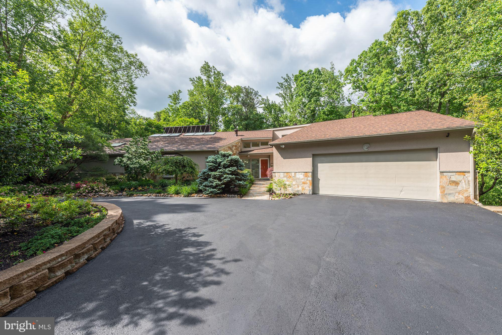 Incredible contemporary home privately tucked away on a secluded lot surrounded by lush parkland boasting nearly 6,000 sq. ft. features newer roof, hardwoods, gorgeous redone BAs, heated 9' x 40' indoor pool & sauna, countless windows w/tons of natural light & beautiful views, lovely kitchen w/stainless, granite, center island & new wide-plank floors, plus walk-out LL w/wet bar/wine tasting room!