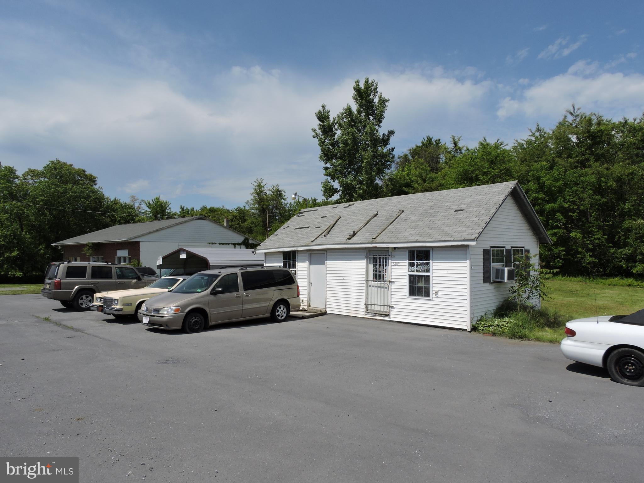 Tremendous value in this high visibility 5.34 +/- acre location next to the old Sheetz store at the center of Kearneysville. Large 50x60 building with 2 potential rental units and another 30x18 building that was historically used as a car lot. Convenient, easy access to Route 9 and Charles Town Road.