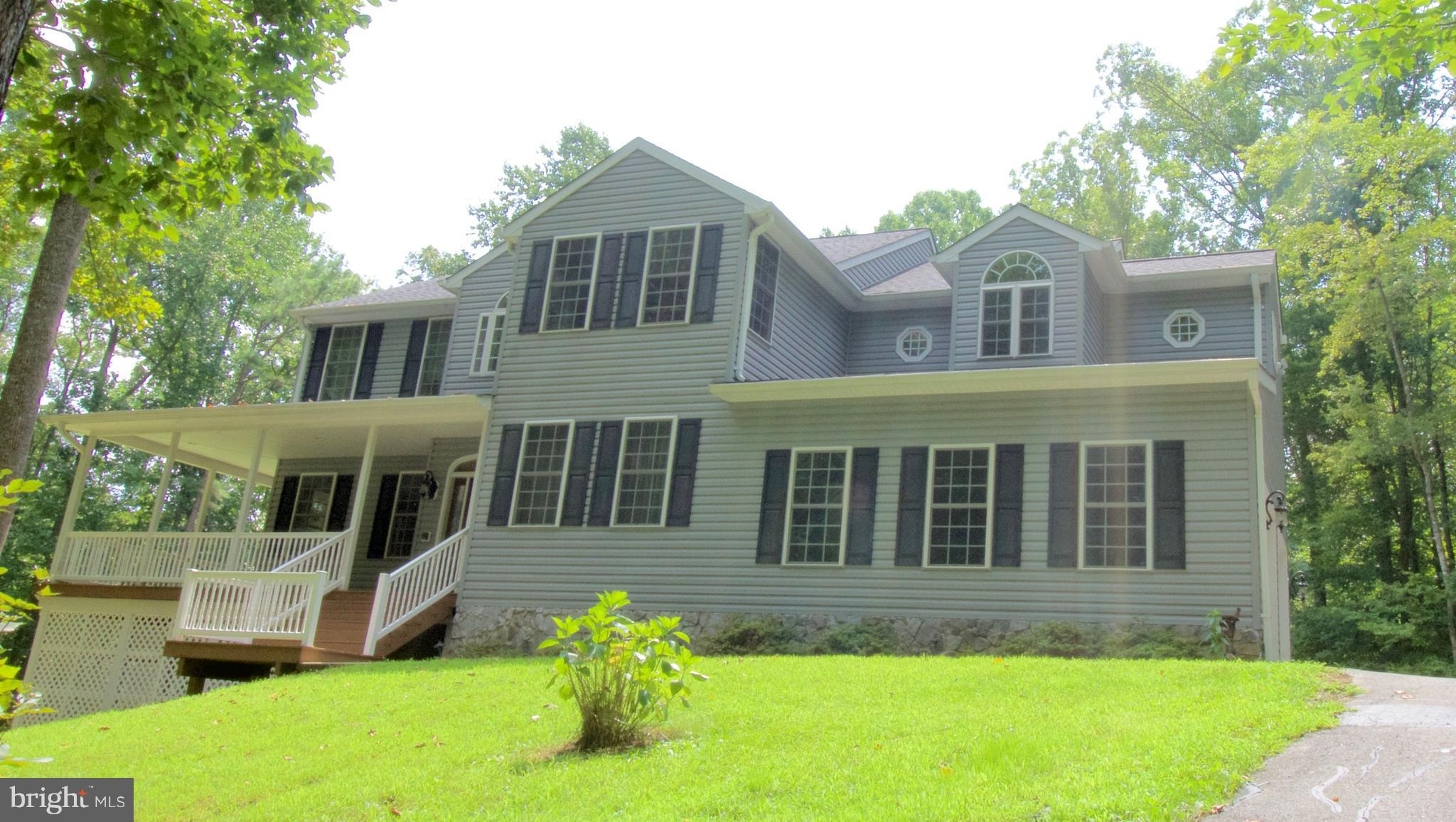 Serenity awaits you in your new 23.32 acre Private Residence! This gorgeous home boasts a Gourmet Kitchen, Hardwood Floors, Oversized Rooms, 2 Master Bedrooms w/ the Main Master Bedroom having a Fireplace, Sitting Room, Tray Ceilings, and an enormous  Master Bathroom w/ a Jetted Soaking Tub that you will love! No HOA! This driveway is already designed to house your RV's, Boats, and other Vehicles.