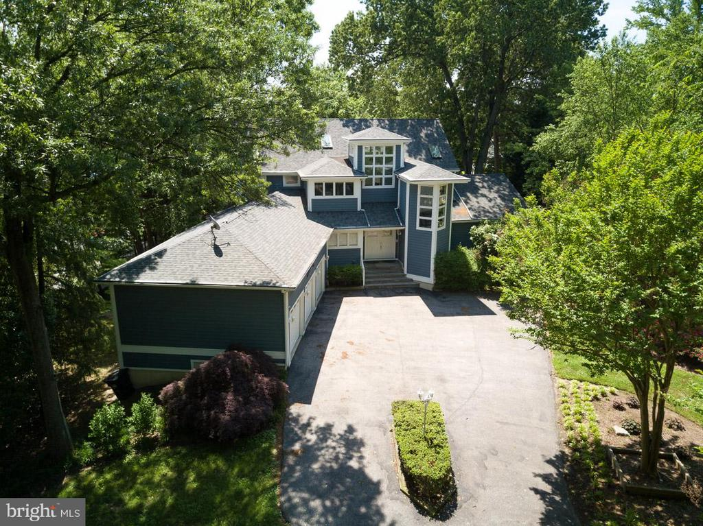 Almost every room has a water view. Trex deck,w/screened in porch. Private TREX Pier-6ft median water 115 water frontage,w/2 boat slips, 1 boat lift & jet ski lift. 3 CAR GARAGE WITH WORKSHOP-This house is an entertainer delight with a gourmet kitchen, stunning water views and huge flat backyard! Not to mention oversized driveway - room for 10 cars! Full house generator- Tesla charging station! Enclosed dog run w/door. $400k in upgrades! This is one of a kind! Come and experience for yourself!