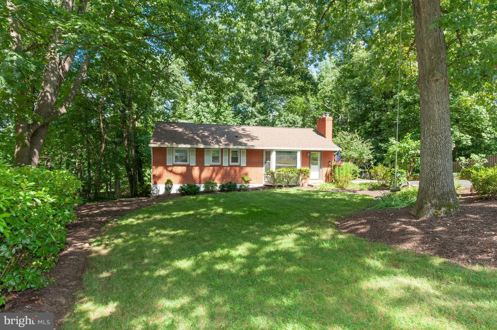 Nearly .5-acre lot backs to trees & completely renovated SFH with outstanding screened-in porch, gorgeous hardwoods & oversized 2-car gar w/heat & AC ~ perfect for home-based business! Updates include eat-in KIT boasts granite & stainless GE appliances, MBR w/huge sitting area, renovated BAs, LL walk-out rec rm, bonus rm w/door to dual entry BA! Park-like setting super close to I-495 & metro!