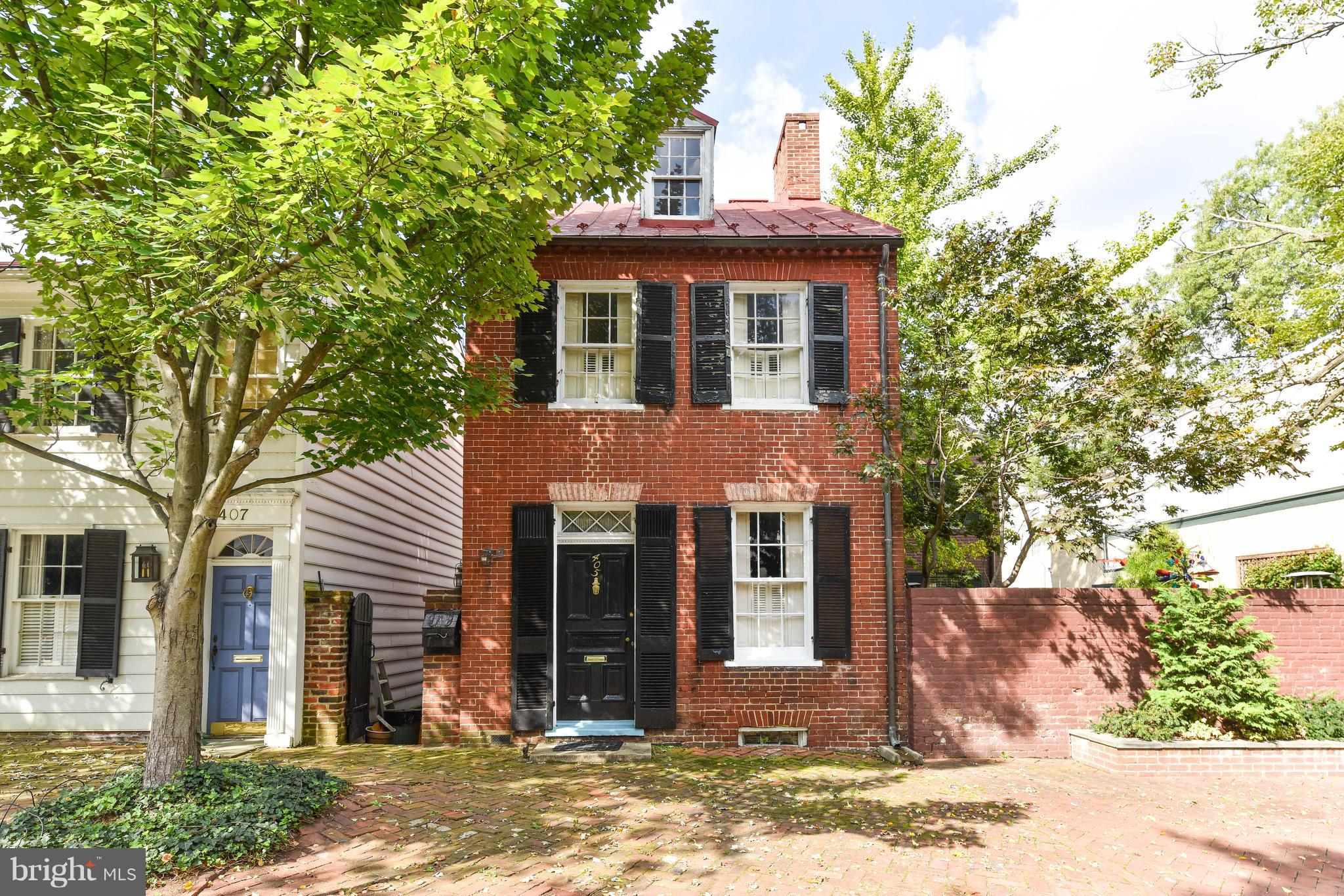 Beautiful historic brick home located in the heart of SE Quadrant Old Town just 3 blocks to King Street. Stunning original details throughout, 3 fireplaces, large, private garden with potential for off-street parking. Abundant natural light, double parlor and separate dining room. Unique opportunity to fix up and make this gem your very own.  As-is sale.