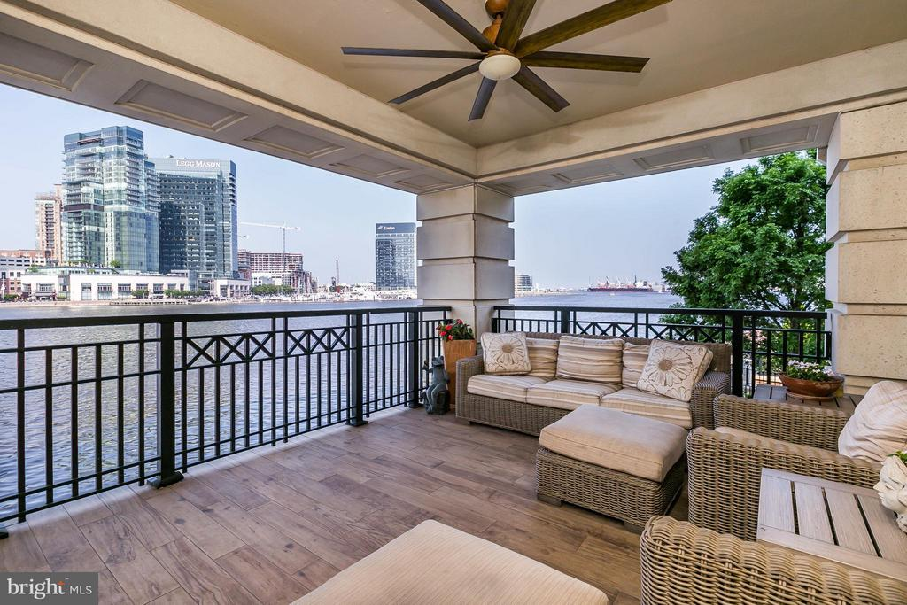 Breathtaking garden & Inner Harbor views combine to make this designer unit your oasis in the City! As featured in The Baltimore Sun Dream Homes, this former model boasts impressive upgrades thru-out. Sun-filled, beautifully appointed w/ gracious rm sizes, this home is sophisticated, comfortable & offers gorgeous vistas from every room. Enjoy relaxing on the spacious terrace morning, noon & night!