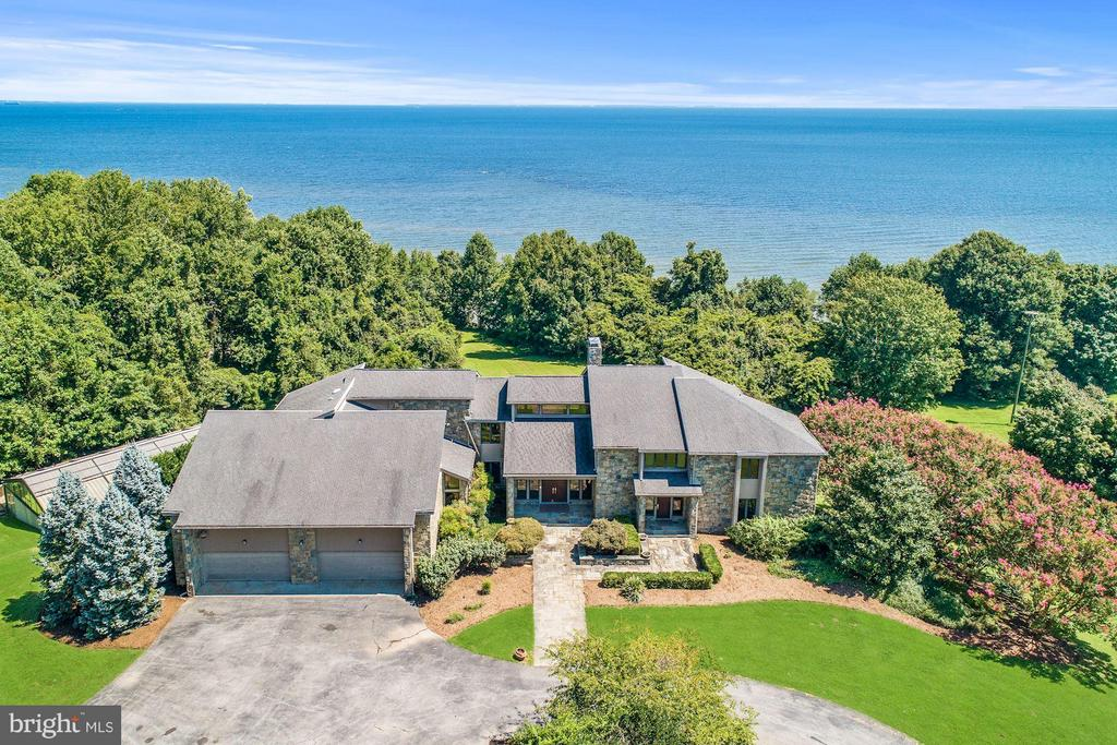 Grand gated waterfront estate on approx 537 acres with over 1 mile of water frontage on the Chesapeake Bay.  17,000 sq ft main house with vaulted cedar ceilings, expansive rooms and open light filled design. Indoor pool in glass pavilion / subterranean gun range / tennis courts / sports fields / basketball courts / guest houses / AMAZING.  Extraordinary privacy. Can be subdivided for development.