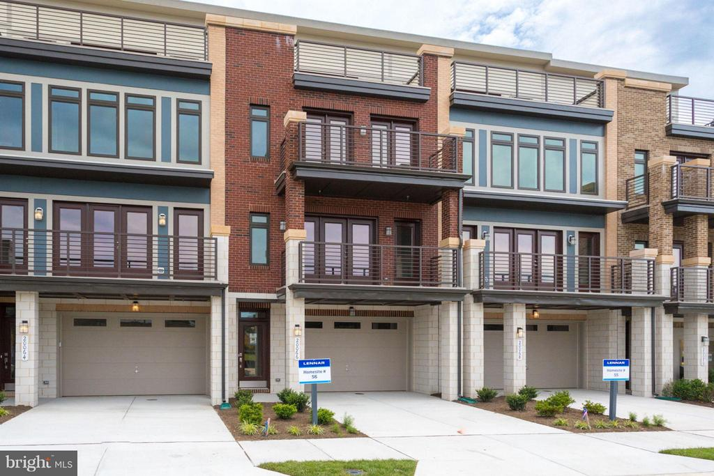 Brand new 4 level urban contemporary styled Townhomes finished on 4 levels. 4th floor loft and rooftop terrace is included! Amazing included features.  Neighborhood backs to Washington and Old Dominion Trail along with a footpath within the neighborhood to Belmont Station Elementary School.  We have quick move in homes if you don't have time to build. Photos are of a similar home.