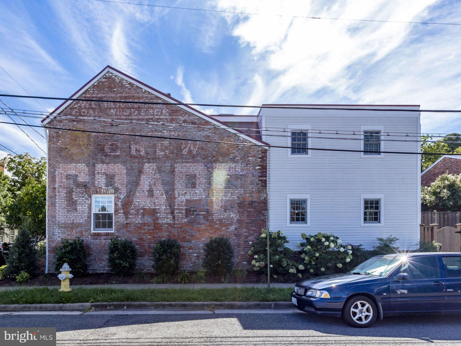 One of a kind 'Grape' House in Old Town! Circa 1840's historic home fully renovated in 2015 including new HVAC, plumbing, electric, hardwood flrs, gourmet kit w/granite & SS appliances, gas FP/stove, luxurious master suite, built-in shelving, exposed brick, etc. English basement w/lots of storage. 2 BDRM/ 2.5 BA. Fully fenced patio w/gas fire pit. Furniture Conveys! Steps to everything!