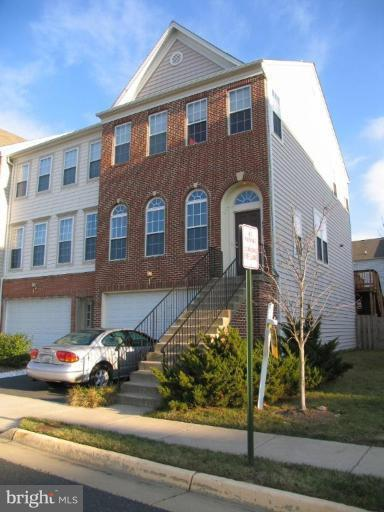 SPACIOUS END UNIT FILLED WITH NATURAL LIGHT. LG DECK OFF KITCHEN WITH STEPS DOWN TO GROUND LEVEL.  FINISHED BASEMENT WITH FIREPLACE.  EASY ROAD APPROACH AS PROPERTY IS END UNIT ADJACENT MAIN NEIGHBORHOOD THOROUGHFARE. METRO 1.2 MILES. FREE METRO SHUTTLE 100 YARDS FROM TOWNHOUSE.