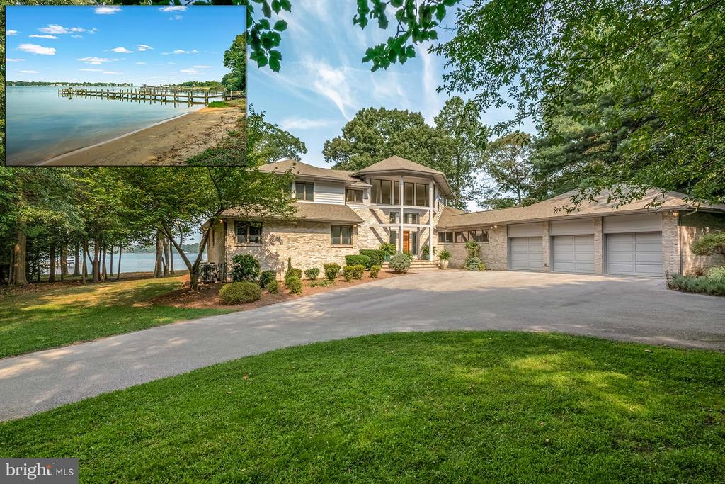 Waterfront home in gated community with private pier! Sweeping views out to the Chesapeake Bay. Gourmet chef's kitchen has a large center island with breakfast bar, top-of-line appliances, huge butler's pantry, and granite counters. Hardwood floors, soaring ceilings, and walls of glass throughout this gorgeous architectural gem.Private master suite with waterside deck. Truly a must see, TOUR IT!