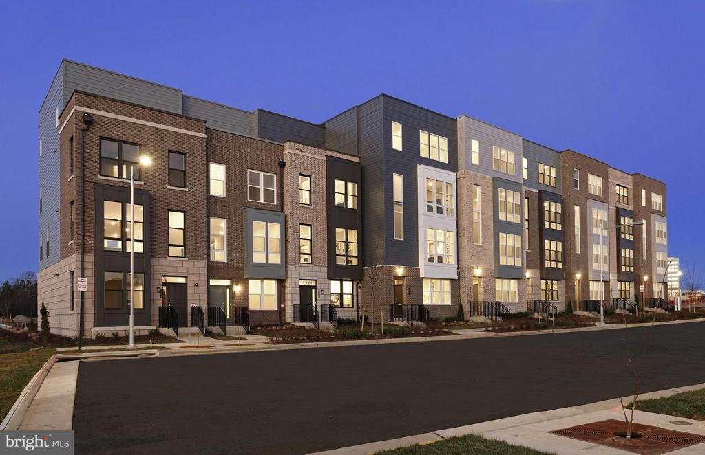 NEW HOME. MetroPark at Arrowbrook. Brick Luxury 2 Story Townhome Styled Condominium w/1 Car Garage and Full Size Driveway.  Walking Distance to the future Metro and shopping center!The Saratoga's versatile design allows you to personalize the space to fit your lifestyle. An optional gourmet kitchen makes entertaining a breeze. Make the sitting area on the second floor of this condo a small home office, leaving two secondary bedrooms available for family or guests. This condo is ideal for couples or families. 52 acre Mixed Use Development with basketball courts, tennis courts, soccer field, dog park and more! Call (866) 885-1744 for more information.
