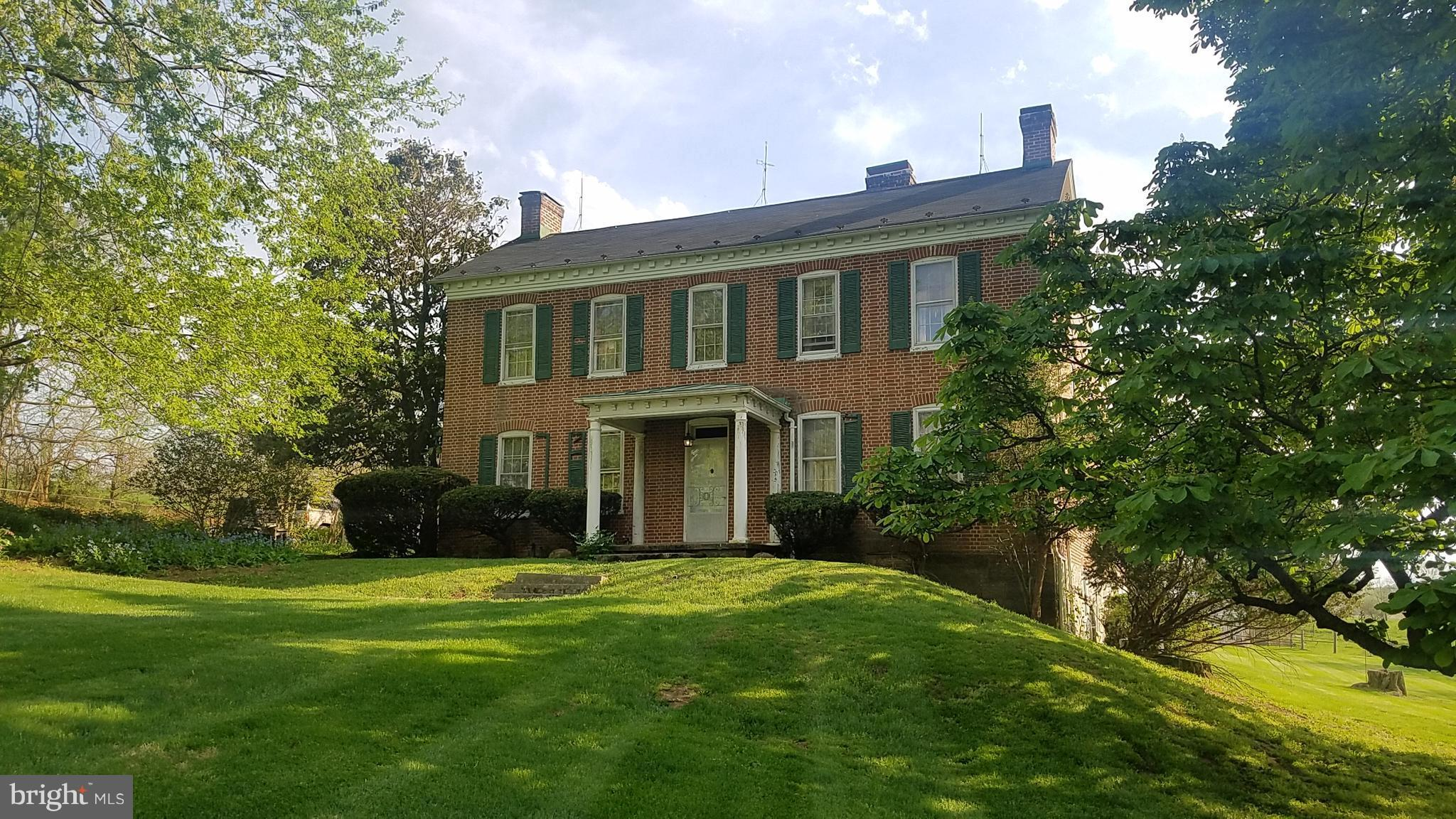 """""""Boyd Brooke"""", built in 1869, 15+ acres with way too many amenities to list entirely, sits minutes from the city, but seems miles away.  Park-like lawn with historic, stone spring house, meandering creek, bank barn, run-in sheds, corn crib, dog kennels, huge indoor pool, 5 bedrooms, main level master bedroom. Majestic home has many updates, ready for your ideas.  Rare opportunity for land,water!"""