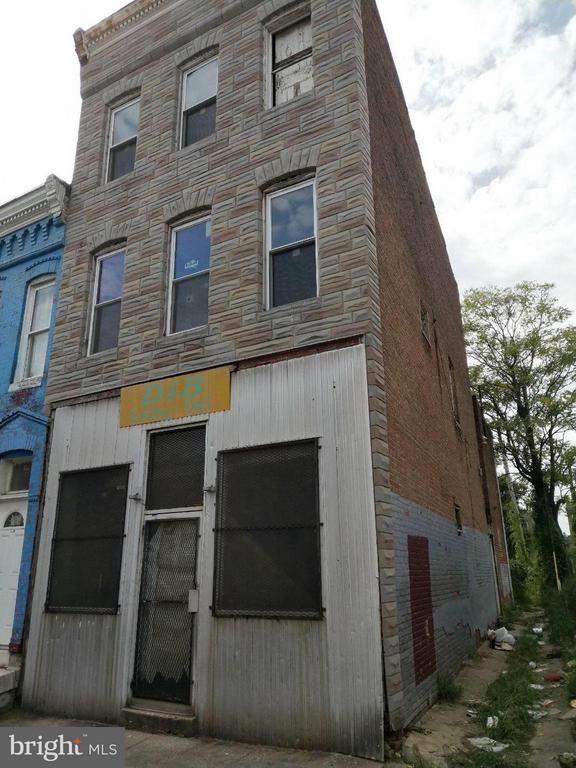 Opportunity to own a corner lot, mixed use store front property in Druid Heights. Former store front on 1st. floor.  Potential for apartments on 2nd and 3rd floors. Completely gutted out. Conveyed in As-Is condition.