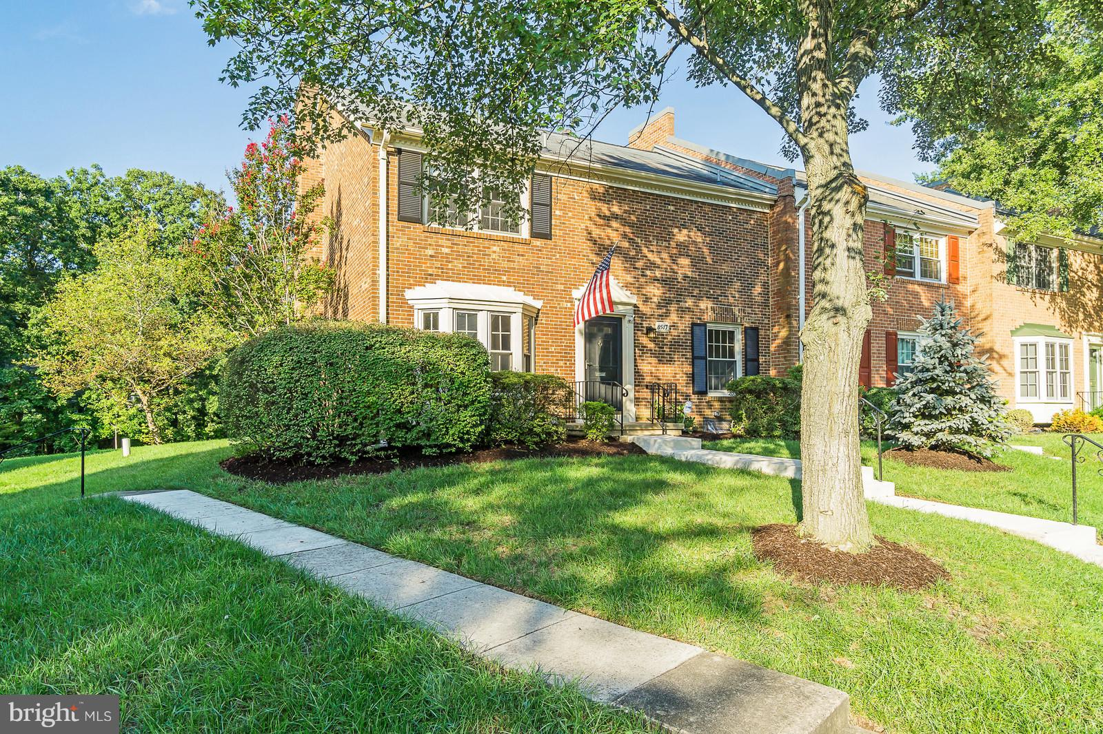 Stunning, all brick townhome with brick walls surrounding the serene backyard. Main level bedroom, large master bedroom with huge walk-in closet, large rec room & living room, eat-in kitchen, large pantry, curved staircase, two oversized sliding glass doors to the backyard, two parking spots & ample visitor street parking, and so much more! Close to Whole Foods & tons of shopping. Original owner!