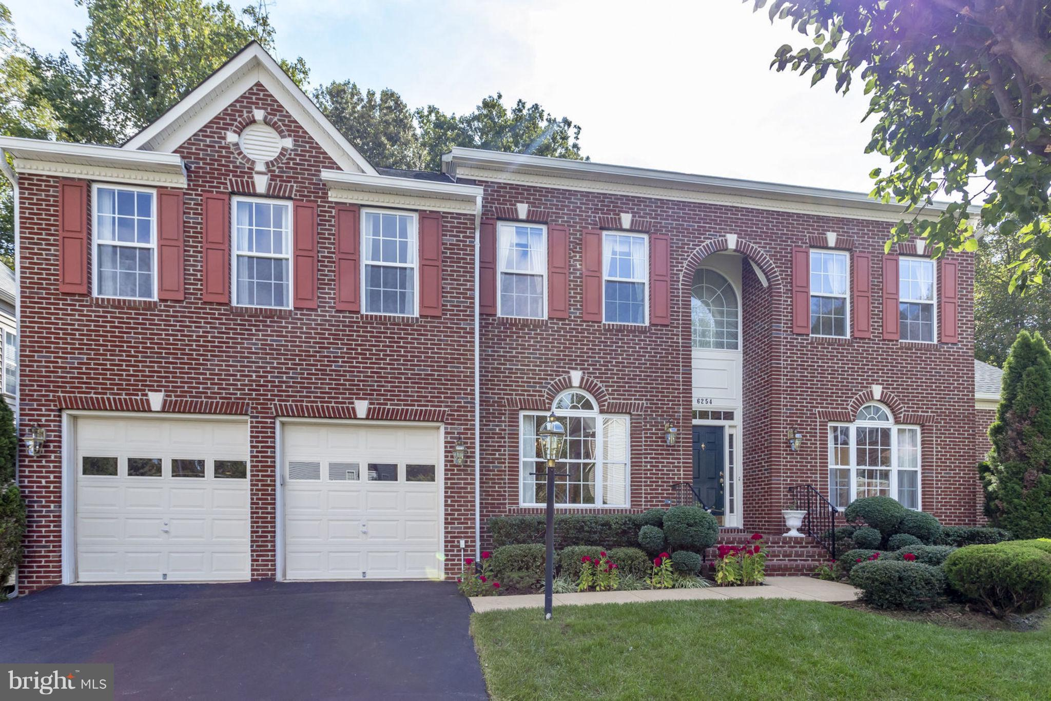Stunning VanMetre Colonial nestled in a quiet cul-de-sac behind W. Springfield HS! This 6100 sq. ft. beauty boasts an incredible open floor plan, soaring ceilings, updated kitchen, hardwoods throughout Main Lvl, skylights, too many extras to list.  Master suite w/sep. sitting area w/gas fireplace! Large private deck that backs to woods.  Huge finished walkout basement with 2 bedrooms, full bath.
