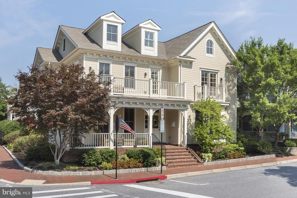 NEW PRICE....Spa Creek Water Views from this Refined, Beautiful Historic Annapolis home with unparalleled finishes in a prime location. There is no other property in the Historic District that is finished to this level of workmanship, quality and details....NYC sophisticated combined with the Annapolis lifestyle is a winning combination. The covered, front porch, has lovely views of Spa Creek and is great for relaxing but also the perfect spot to visit with neighbors. The hardscape of the back patio is lovely with mature hollies providing privacy and a wonderful place to entertain your guests or have morning coffee. Custom woodwork through, crafted in New York, Jerusalem Limestone square tile floors with various inlay materials, including honey onyx. Fluted millwork door frames and columns, red oak wide plank hardwood floors....some with parquet border surround, Custom plantation shutters, Custom, cut out balustrade railing with inset gilded orbs. Too many details to list but they are amazing.The master suite on the second floor is huge with a sitting area and his/her private bathrooms with two very large walk-in closets.  The guest bedroom on the same level has an en suite bathroom and faces the park. The third floor is flex space with 1-2 bedrooms and a full bathroom. This is also great space for kids to play.The 2 car garage is detached and is finished on the second level with a lovely, private guest suite.Tie up your boat at the public dock and enjoy Swan Park. Walk to town, City Dock....enjoy the Annapolis lifestyle in all ways possible from this outstanding home.