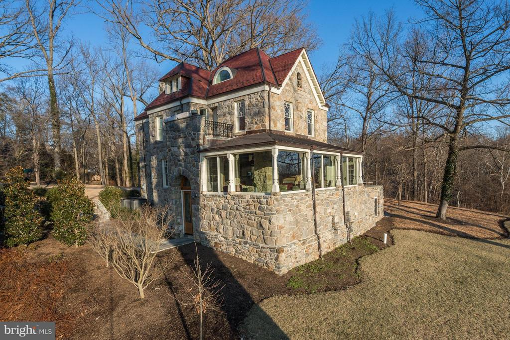 Fabulous renovation and expansion of historic fieldstone home originally built in 1888 and brought to today's modern standards buy it's current owner/builder. Expansive picture windows showcase the spectacular tree top views and exposures of the Potomac River. Four beautifully finished levels.  Please view virtual tour for interior photos. Rare opportunity.
