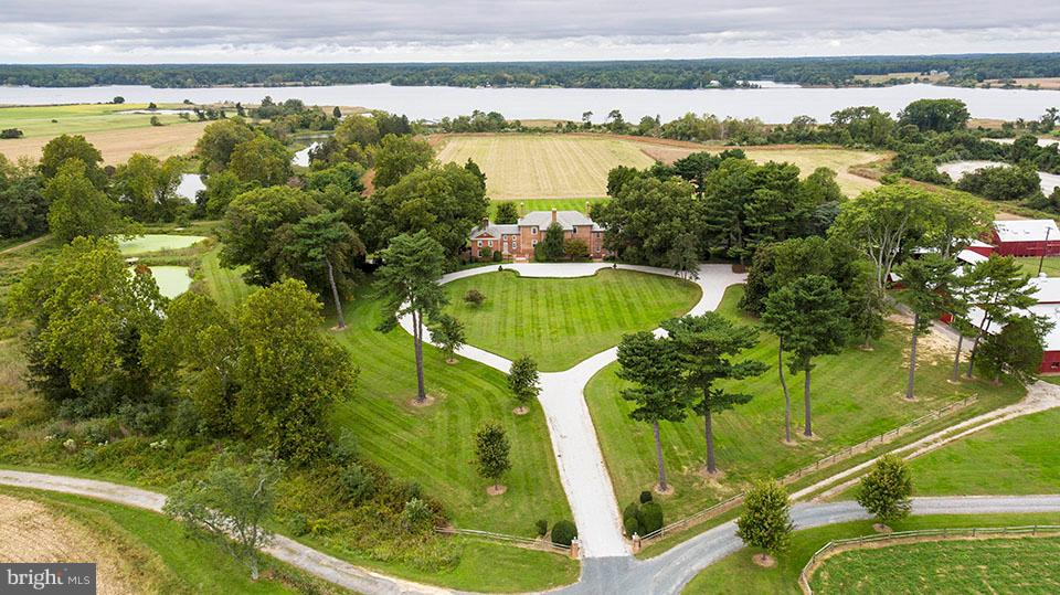 """Readbourne"" - Rare Opportunity to own one of the last  largest tracts of land available in Queen Anne's County.  Waterfront estate on 973 acres offers 14,000+ sq. ft. Historic home on the Chester River with over 4000 ft of waterfrontage.  3 Guest Houses: 4BR/2BA, 3BR/1.5BA, 3BR/1BA. Pool, Tennis Court, Full Skeet Range, Multiple Barns, 11 Ponds (3 floodable).  Approximately 550 tillable acres.  Great Hunting Property!"