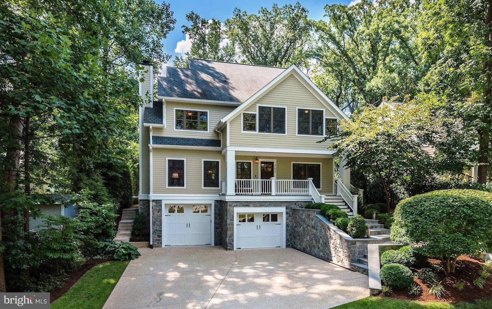Exquisite 6BR 5.5BA custom home w/ oversized 2-car gar in park-like setting-over 5,200SF of luxury! Fabulous Kit w/ 6-burner stove, dbl oven, 2 D/Washers, granite & bkfast nook. Main LVL guest suite, den, 2 FPLs, wet bar & built-ins. MBR/BA w/ dual showerheads & 2 walk-in cls. HUGE LL Rec Rm w/ exercise & 6th BR. Cozy front porch, screened porch, outdoor irrigation/lighting, gas generator & MORE!