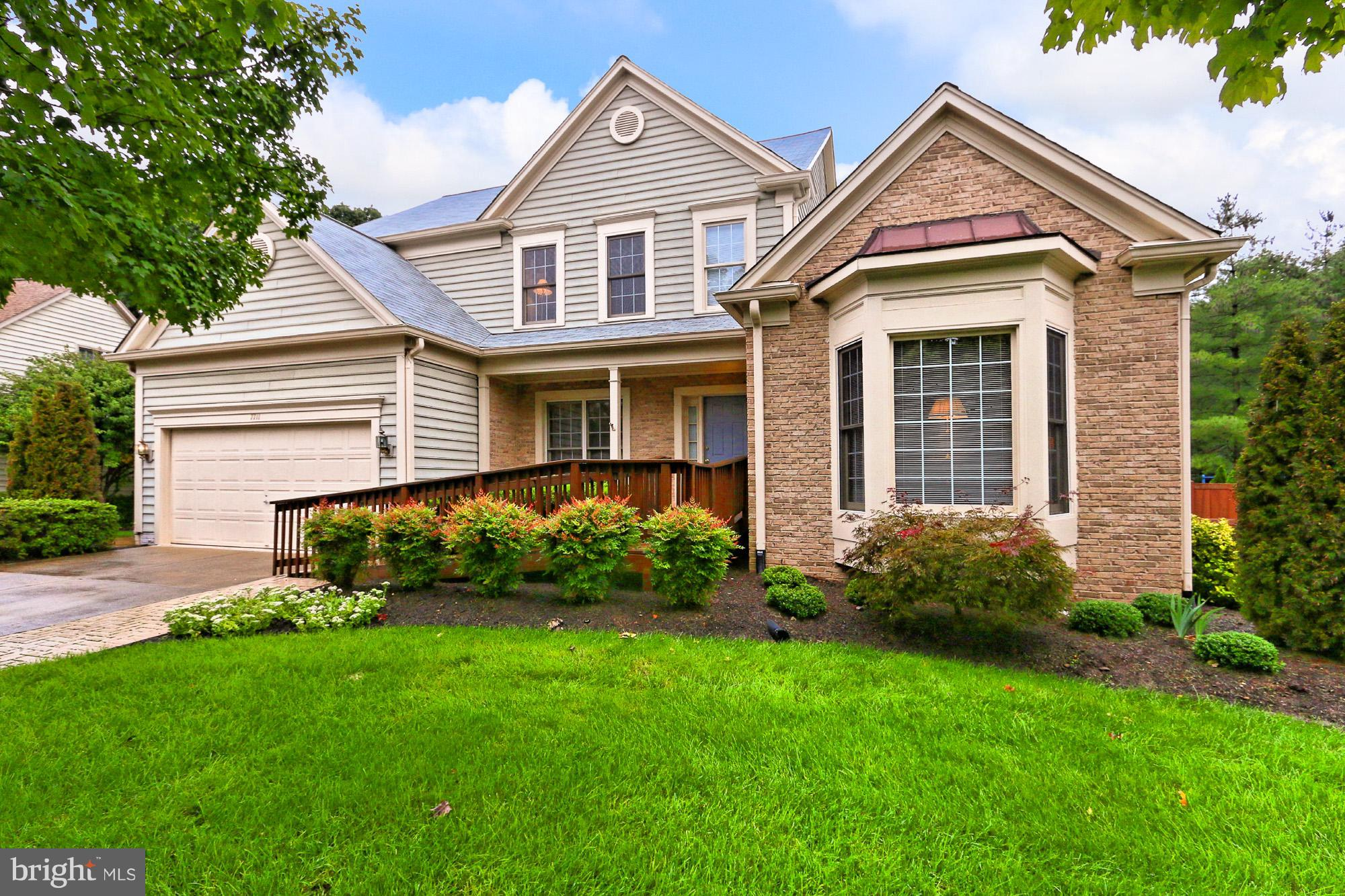 Beautiful Classic Col in Island Creek! Inter. Offers H/W Floors,Two Story Foyer, Main Lvl Master Suite, LR/Library & DR w/Wainscoting, Grand Two Story FR w/2-Sided Gas FP to Kit, Large Eat-In Kit w/Center Island, Walk-In Pantry & Breakfast Nook w/Slider to Deck! Upper Lvl Boasts 3 BRs, Incl Master Suite #2 w/Remodeled BA! Walk-Up LL has a Large Rec Rm w/Gas FP, Den, Exercise/Game Rm & Full BA!