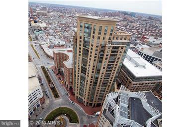"""LOCATION LOCATION - NEXT TO NEW FOUR SEASONS & LEGG MASON BLDGS -WATER & CITY VIEWS.""""The Vue"""" Inner Harbor East's, Fresh paint, Luxurious 2 Bdrm, 2 Bath condo, Over 1400 + Sq.ft, Gourmet kit, granite counter tops, wood floors, crown mouldings, walk to restaurants, JHU, shopping, theatre, whole foods & easy access to Rte 83 &95. 24hr security.The MAC Gym in bldg, indoor pool & more. Short term rental considered. ALSO FOR SALE"""