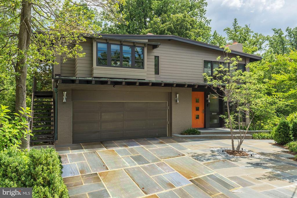 Beautiful, contemporary home designed and built by DC architect Arthur Keyes sits on a private yet convenient cul-de-sac in Mass. Ave. Heights with 5BR/5BA & 1HB. The main level features a large family room with beautiful natural light from the over-sized windows. The upper level features a spacious living room, dining room, kitchen, and deck. Lower level has a spacious rec room, laundry, and full gym ft. sauna. 2 car garage parking.