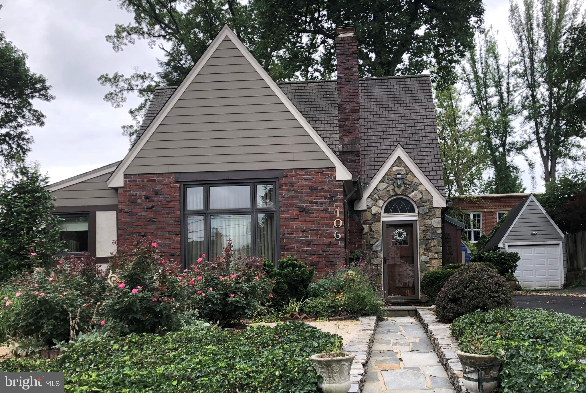 One of a Kind!! Tudor style brick home w/2-story  Great Room, Sunroom, kit, Sep DR leading to gorgeous garden!  Bedroom on main level.  Second floor has MBR and BR #3.  Updated Full Baths on main level and second level.  Wood floors throughout.  Separate garage plus driveway for 4 more cars!!!  Verbal conversation with City says room for 800SF addition.     Single garage + park 4 cars in driveway.