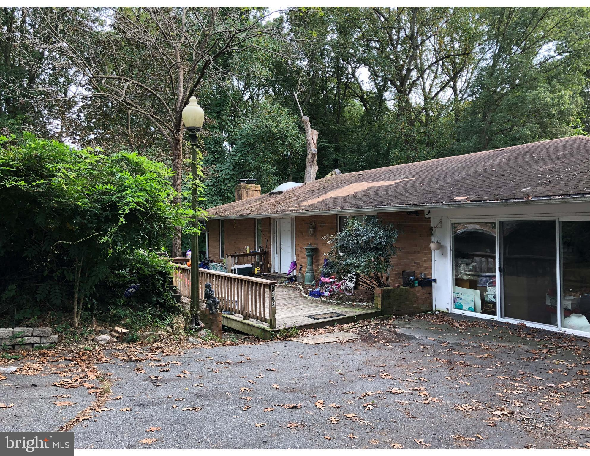 Build out, Build up, Build new! Welcome Investors! Home being sold AS-IS. Conventional & Cash offer accepted, 2 Level home on .43 acres. No HOA, HVAC