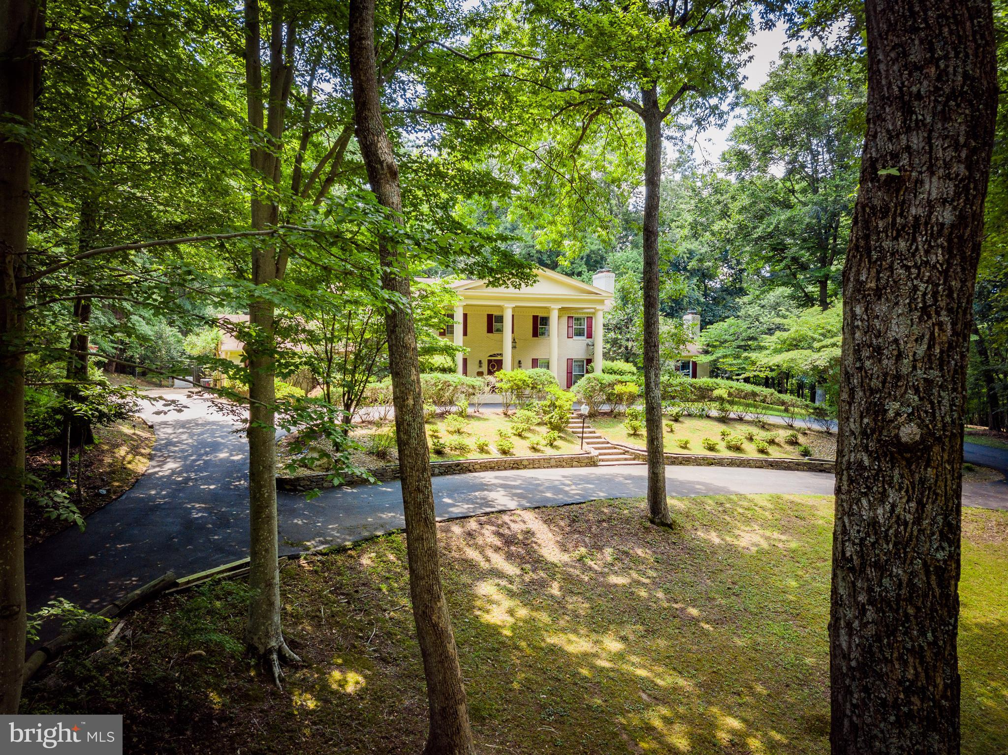 Serene & private 5-acre property w/swimming pool and great outdoor living w/ jacuzzi, patio & two decks! All brick Colonial w/circular driveway has so much to offer!Main lvl Master Suite w/2 full BA! Cathedral ceiling, skylights & windows in extended Sunroom *5BRs & 2FBAs in Upper Level!  Priced to sell in current condition-just needs a little updating!Beautiful, wooded Summerwind community.