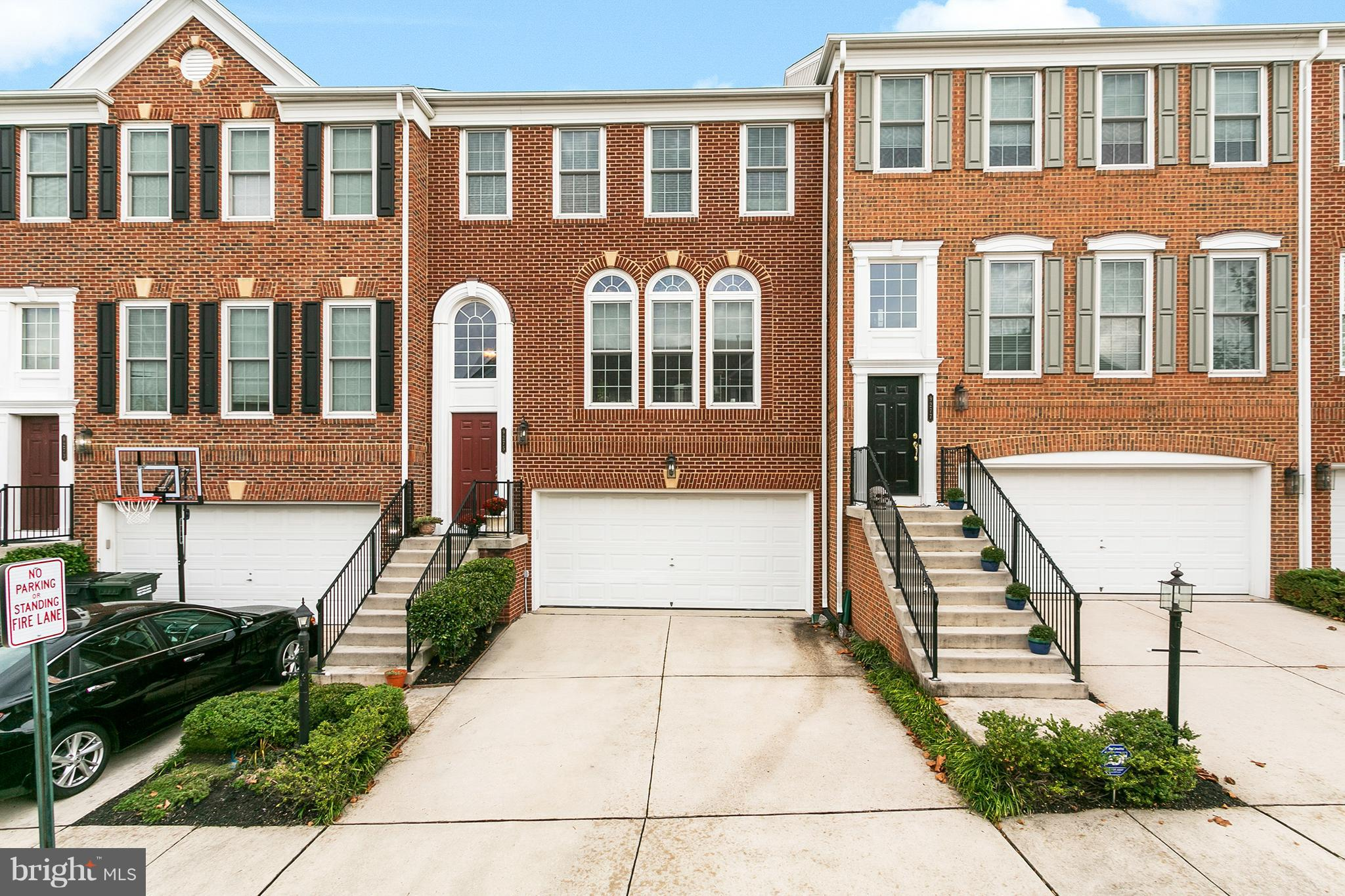 Beautiful brick townhome w/ 2 car garage in Lorton right off of 95! Spacious layout, gleaming hardwoods, huge windows let in tons of natural light. Updated kitchen w/ large island and breakfast bar. Master suite w/ walk in closet. Rear deck overlooks trees and fenced in backyard. Nice, quiet community. Great location for commuters!