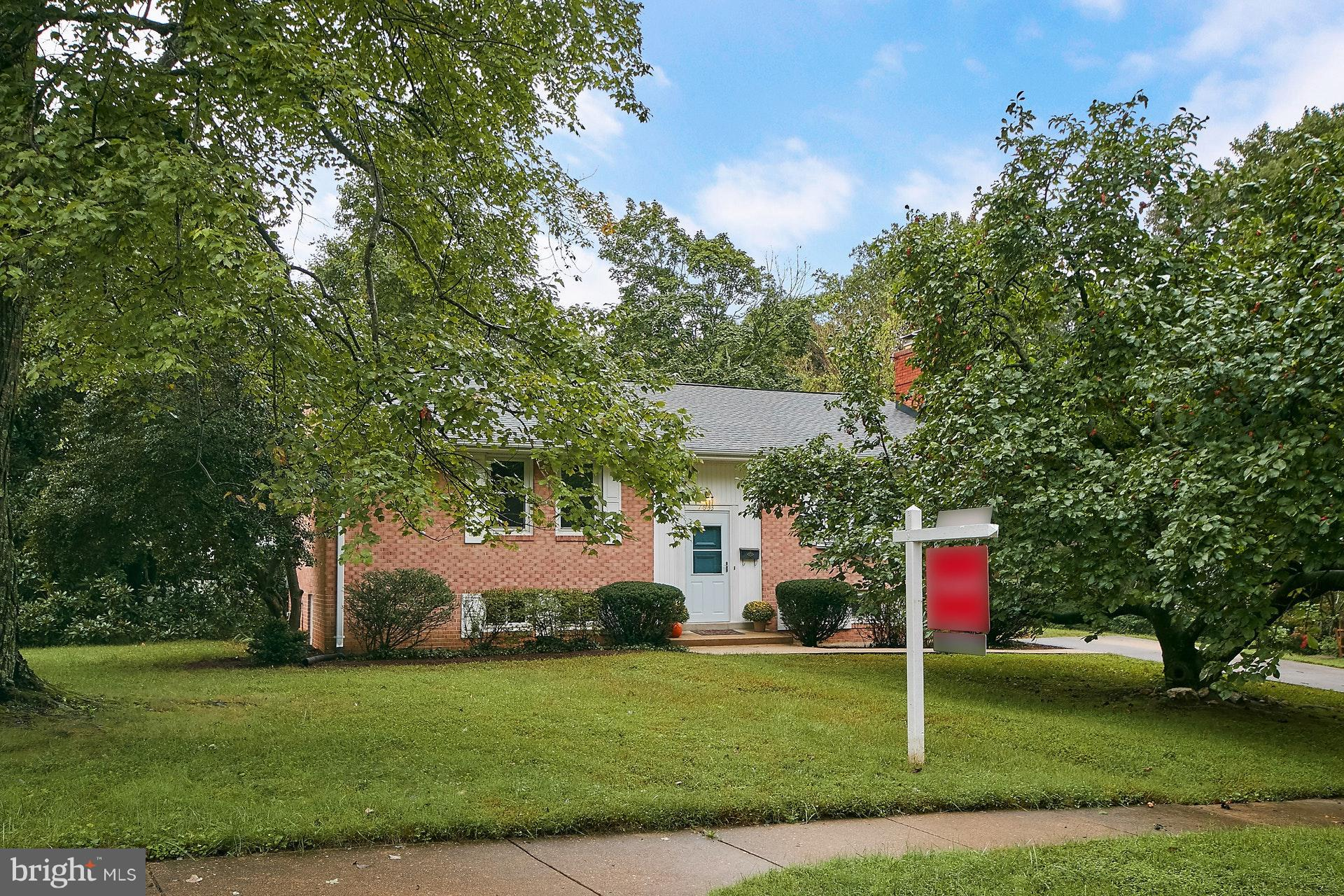 Great potential!! This all brick home is on a great corner lot, freshly painted, hardwood floors on main level, kitchen with corian counters and newer appliances. Fantastic space in the lower level recreation room. Two wood burning fireplaces. Slate patio with privacy wall & attached brick storage shed. Come check out the possibilities!
