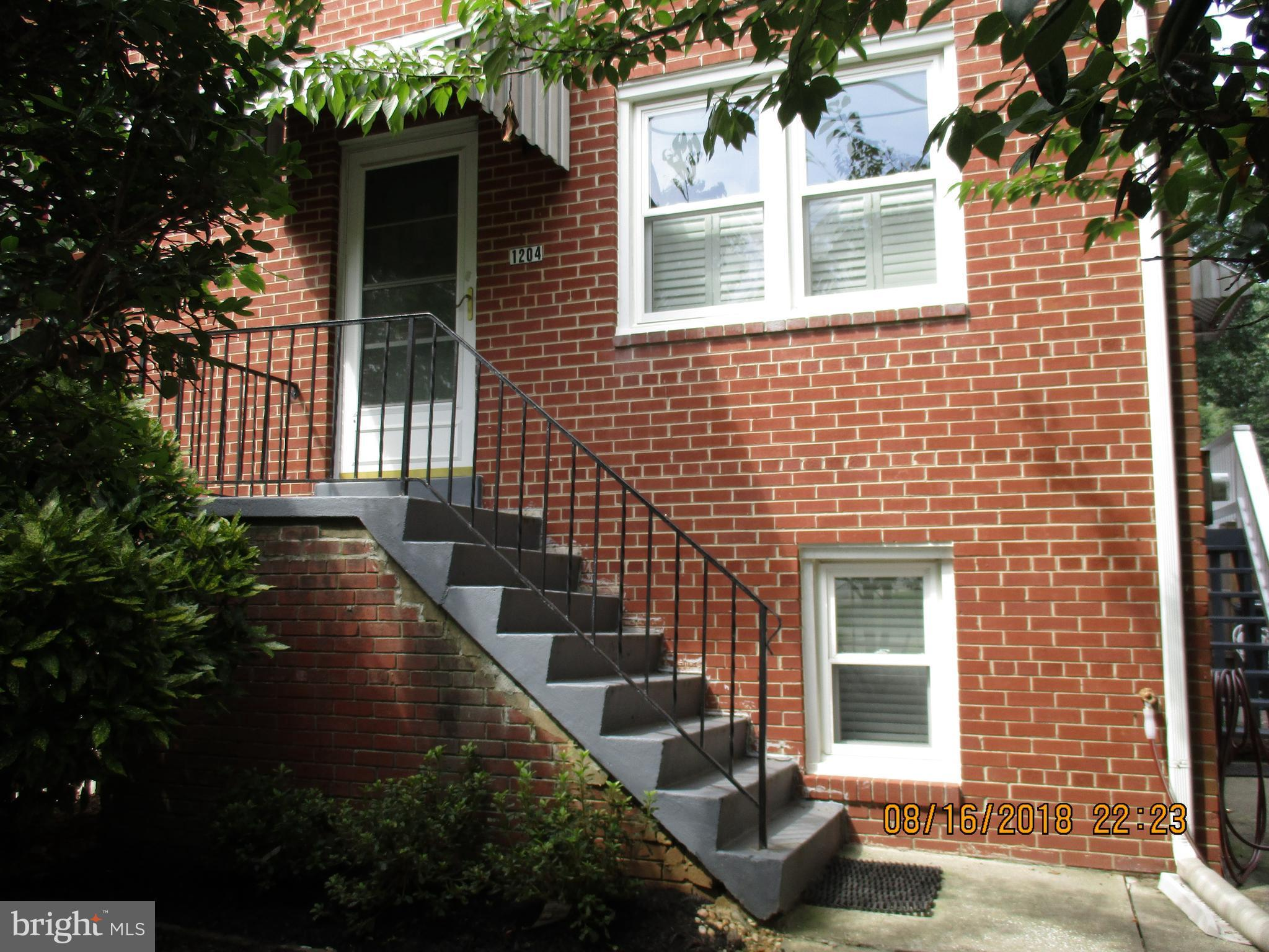 Wonderful, spacious brick duplex less than 1/2 mile to Braddock Metro.  Leave cars in the double driveway & walk to Metro, Del Ray,parks & restaurants.  Freshly painted! Windows on 3 sides! Hardwood floors on main & upper levels, kitchen w/SS appliances, tile floor, granite counters and lots of cabinets. Two nice sized BRs and renovated bath on upper level.  Fin'd lower level with FR & 1/2 bath.
