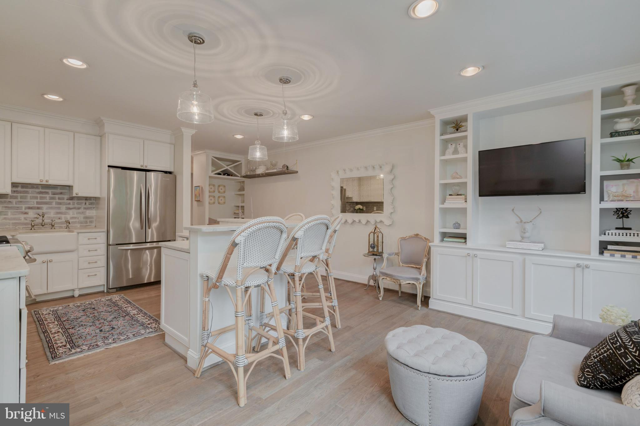 A 2015 magazine-worthy expansion doubled the square footage of this magnificent townhome. Chef's kitchen & family rm w/ Carrara marble, SS, island & breakfast nook. Luxurious master BA w/ clawfoot tub, sep. shower, double vanity. 3 closets & walls of windows in MBR. 4 legal BR! Finished LL w/ full BA. High ceilings, white oak floors & handsome built-ins. Landscaped backyard w/ tiered patio & bar.
