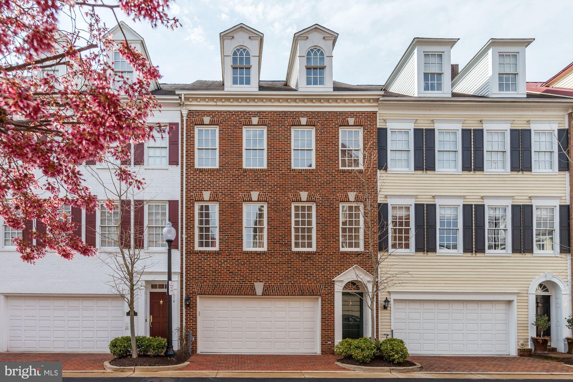 FABULOUS NEW PRICE! Spacious & sun-filled 3BR/3.5BA townhome offering approx. 2900+ SF of luxurious living with view of the Potomac right from the kitchen! Master Suite w/ cathedral ceilings, fp, balcony, 2 walk-in-closets, and master bath w/ double vanity, soaking tub + separate shower. 2nd upper level w/ BR, bath + sauna. Lower Level family room w/ wine cooler + fridge, fp, patio, + 2-car gar.