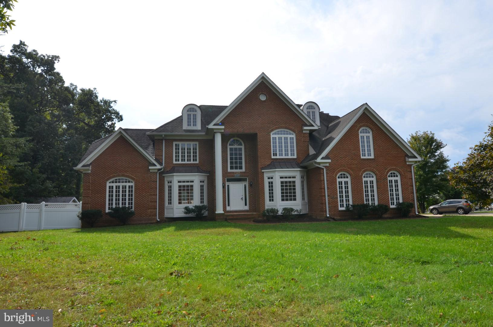 Beautiful all brick single family home with no HOA! Home is close to major commuter routes, the belt way & one mile to 495, 395 & 95. Home has beautiful hardwood floors, marble floors in the gourmet kitchen, w/cooktop, island, & breakfast bar. Huge family rm, w/floor to ceiling stone fireplace, formal living rm w/fireplace, & separate dining rm. Finished walk-out lower level w/rec rm & bar area.
