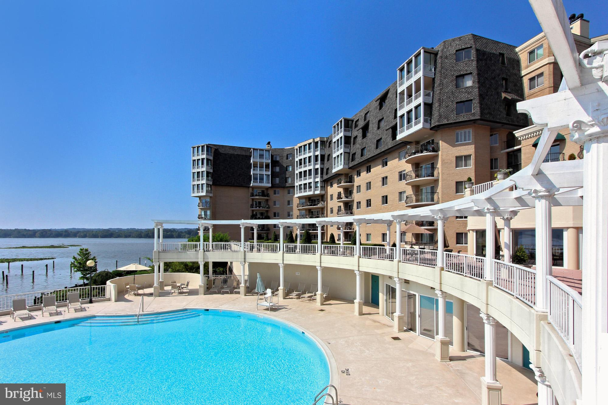 Welcome to resort style living at Porto Vecchio! Bring your special touches to this 2bed/2bath condo w some of the best views in the building--overlooking the Potomac river straight into National Harbor. Original parquet under carpet, gorgeous semi-circular balcony to savor the views, 2 car garage parking + additional storage. Gym, tennis, pool, sauna, security, front desk, limo service, etc, etc!