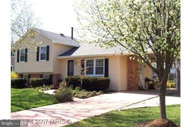 MUCH REDUCED!!! LOVELY SPLIT LEVEL W/ 3 BR & 2 FULL BA, WOOD FLOORING, KITCHEN WITH GRANITE COUNTER-TOP, FRESH PAINT, NEW ROOF, NEW WINDOWS, NEW SIDING, DINING ROOM W/ SLIDING GLASS DOOR TO NICE WOOD PATIO DECK...YOU'LL LOVE IT!