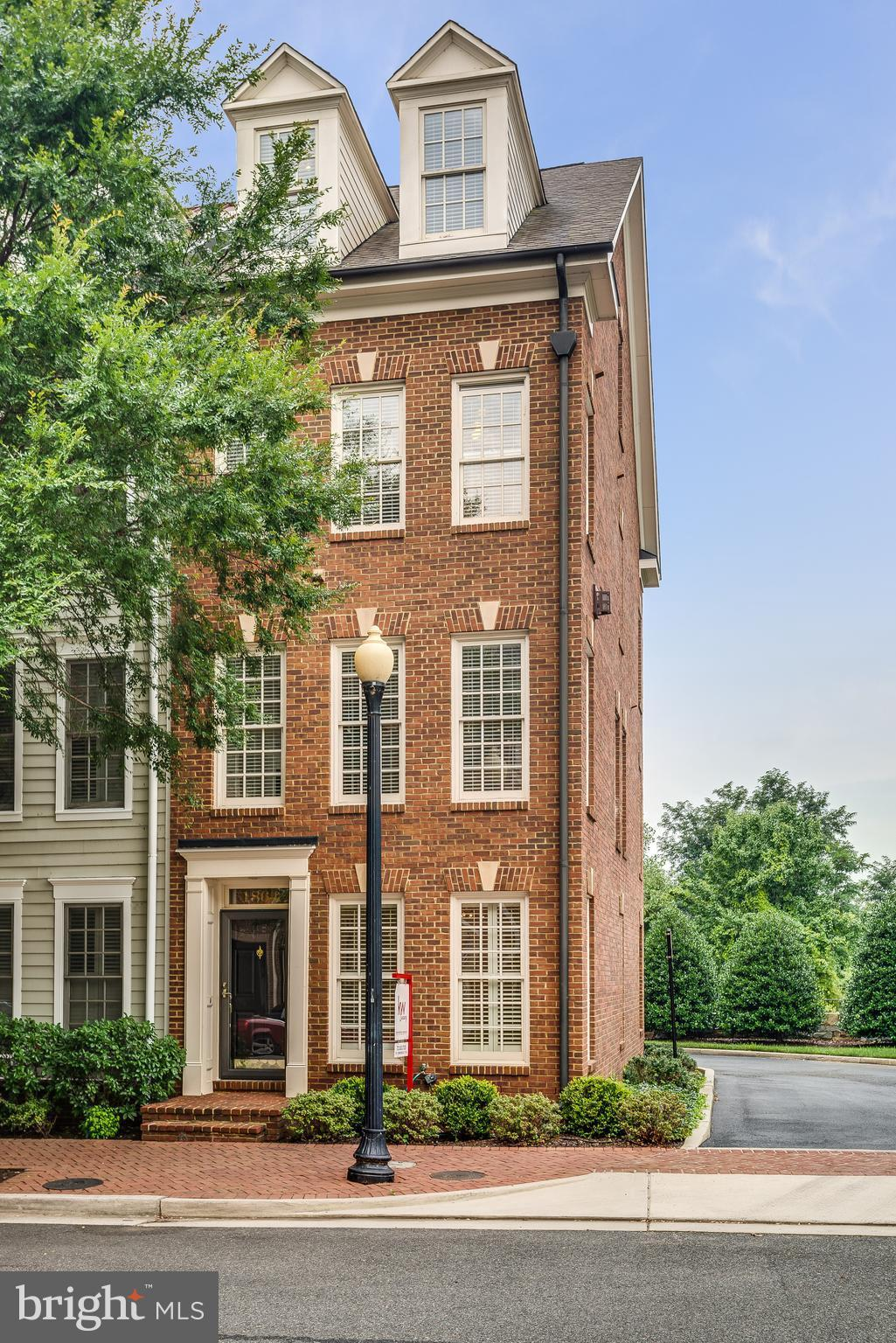 Brick townhome on a corner lot adjacent to neighborhood park with unobstructed views on a beautiful tree-lined street in Potomac Greens. The layout of this home is designed for comfortable living and entertaining.  The main level boasts an open floor plan and a brightly lit remodeled kitchen and breakfast bar. Striking details throughout from lighting, hardwood floors and much more.  A must see!