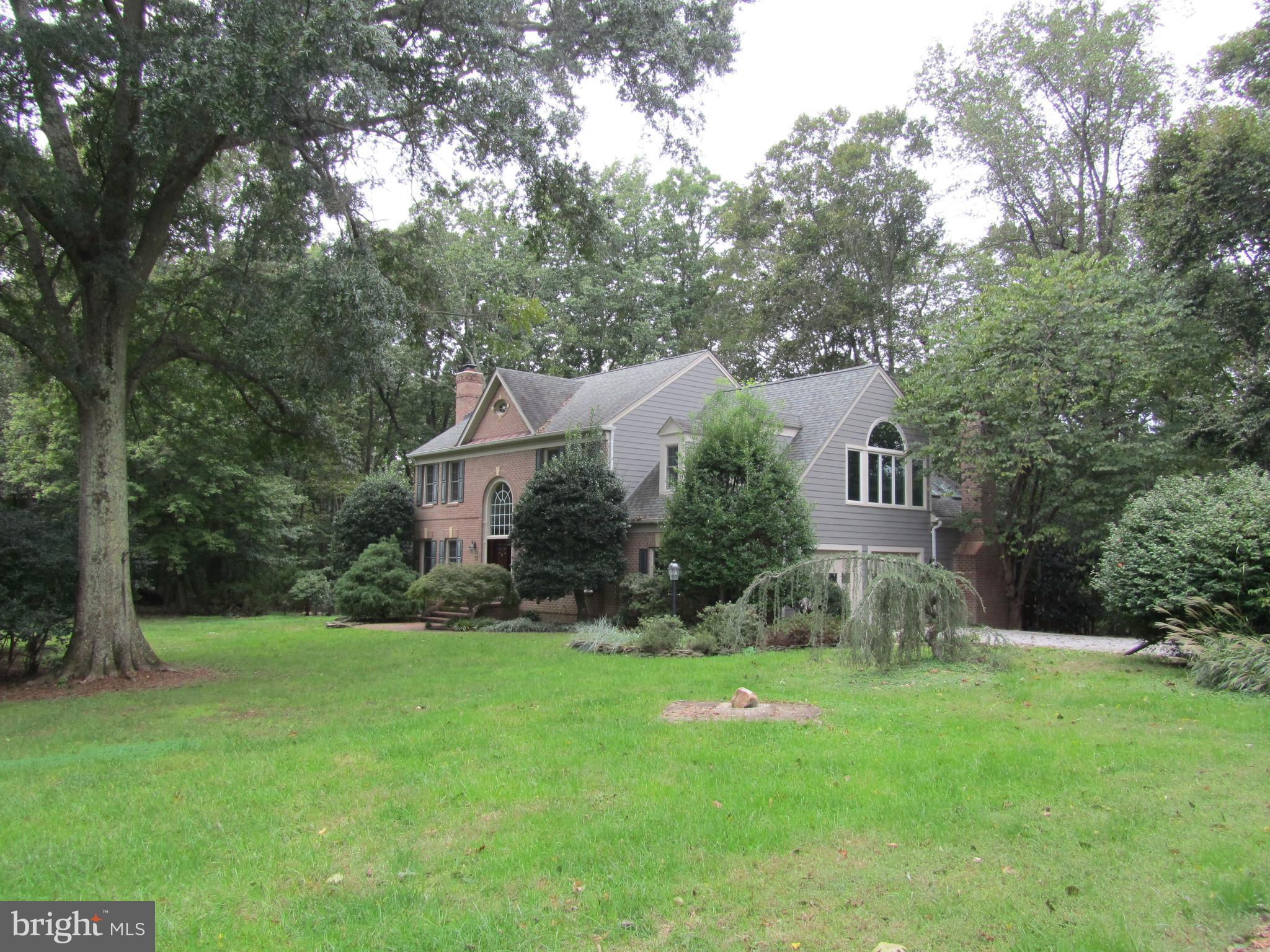 **Tired of look alike crowded S/D houses?**2 ac Lorton location**Gunston, Hidden Gem of Fx.Co**gleaming hardwood flrs., 2 car gar. Anderson windows, Gourmet Kit.w/ high-end appl & family rm., Brick & Hardi-Plank siding, sauna & sun porch. 1000's of acs of Parkland for hiking, boating, golf, etc; Conv. to rest., shop. and easy com.via 95, 2 VRE sta. & Pkwy. to Ft Belvoir, DC &OldTown. must see**