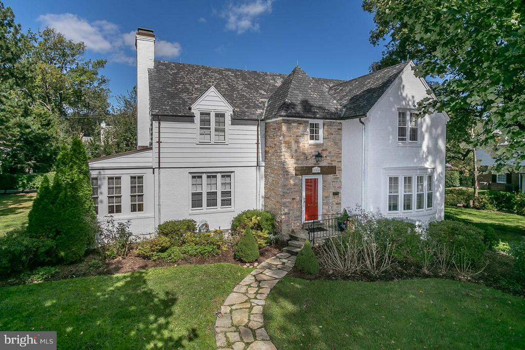 REDUCED! Beautiful and Spacious 4BR/2.5 Bath Stone & Brick Colonial on one of the largest lots in Homeland now available! ALL FOUR BEDROOMS ARE ON THE SECOND LEVEL! Steps to the prep schools - walk to Friends, Cathedral and a short stroll to Loyola College. You'll fall in love with this large beautiful picturesque center stair colonial on one of the most prominent blocks in Homeland with almost 3,000 finished sq ft on a triple lot with .6 of an acre surrounded by gorgeous landscaping. This home features a gorgeous sun room off a huge family room with a wood burning fireplace, a formal dining, stainless steel appliances, gleaming wood floors throughout and a remodeled attached master bathroom. Every room is huge! This home has been thoroughly updated along with a generous finished basement. Enjoy the outdoors with a large rear slate patio with built-in bench. A driveway plus a two-car attached garage. Time to fall in love and be in before the upcoming school year!