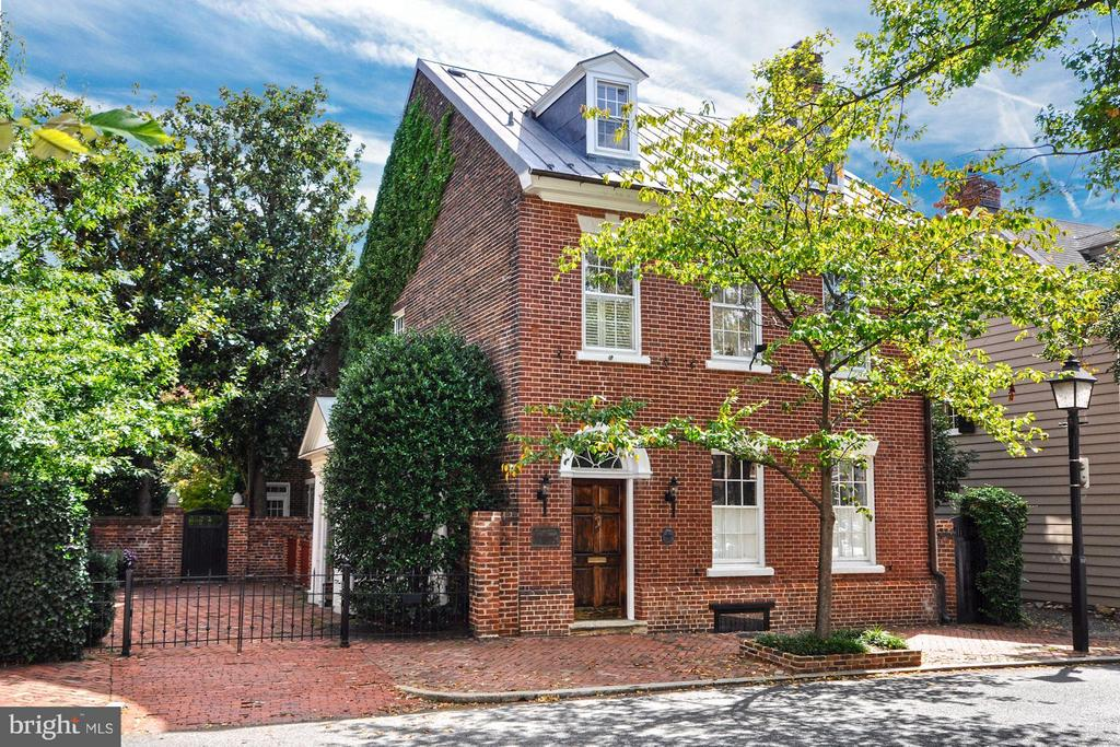 Historically significant detached brick house with new copper roof on 2 lots in prime location w/smokehouse, recent renovations, sun-filled rooms, 2+ car Pkg! Beautiful gardens surround this unique property that enjoys the ultimate in privacy & southern exposure. Hi ceilings, heart pine floors & period woodwork add to the gracious 18th C. rooms w/integrated 21st C. amenities for a grand residence.