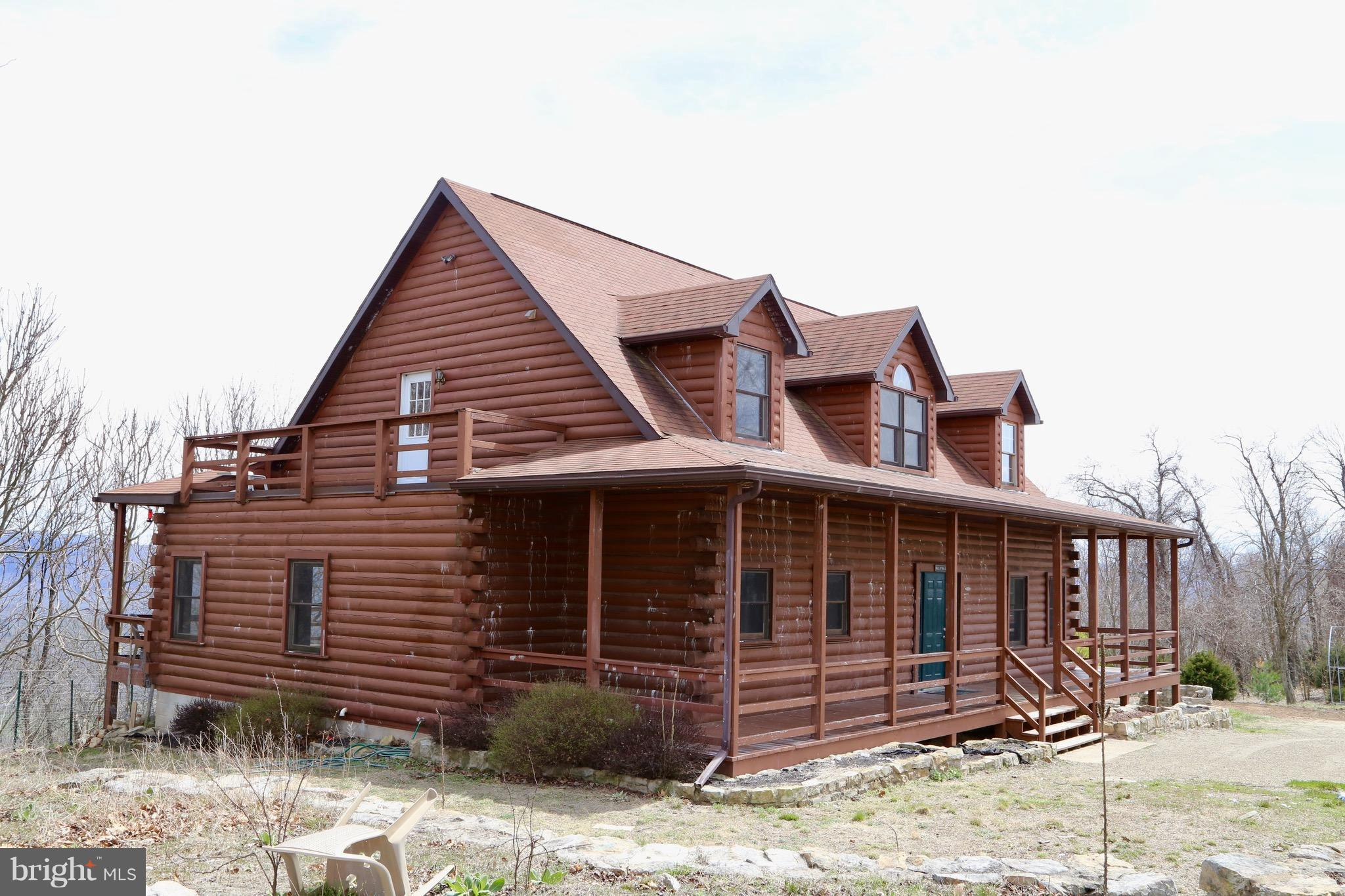 MOTIVATED SELLER.  TAKING BEST OFFER. Majestic Mountain View 5BD/3.BA Log Home w/ mostly mostly wooded 20 acres. Great wildlife in the area.  Amenities include: vaulted ceilings, wood walls and ceilings, upper level and wraparound decks, fireplace in master bdrm, jacuzzi tub, separate 2-bdrm guest quarters with Jack-N-Jill bath, workshop basement. Only 2 hrs from DC, and 30 mins from Winchester. OWNER FINANCING/RENT TO OWN AVAILABLE.