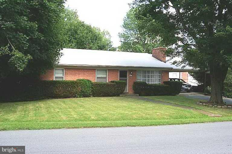 Well maintained 3BR, 1BA brick rancher in the delightful Little Run Acres community.  Home has approx. 1,200 sq. ft. on main level & boasts classic wood floors, brick FP in the living room, separate DR & has a full unfinished, walk-out basement with a small garage with rear access.  Nestled under large maples on a small lot near town and schools.  Age of home predates Jeff Co HD septic records.