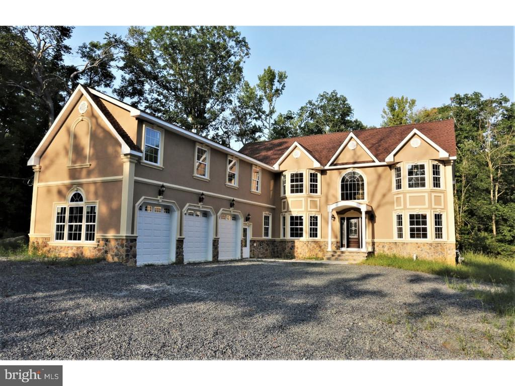 New Custom Colonial on 1.8 acre offering finished area of 7186 SF, 6 Bedrooms, 5.5 baths, guest suite on main floor with full bath, 2 gas fireplaces, 3 car garage insulated/finished with separate heating system, 2 zone heating/central air, 300 AMP electric service, large living room with french door to deck, study and dining room offers bay windows, finished walkout basement, stairs to attic to another floor with windows for storage, stone and stucco front, central vac, large master suite with sitting room, fireplace, skylights, cathedral ceiling, large walk in closet with second laundry hookup, custom kitchen with island,granite counter tops, separate dinette and formal dining room, tons of LED recessed lighting throughout.