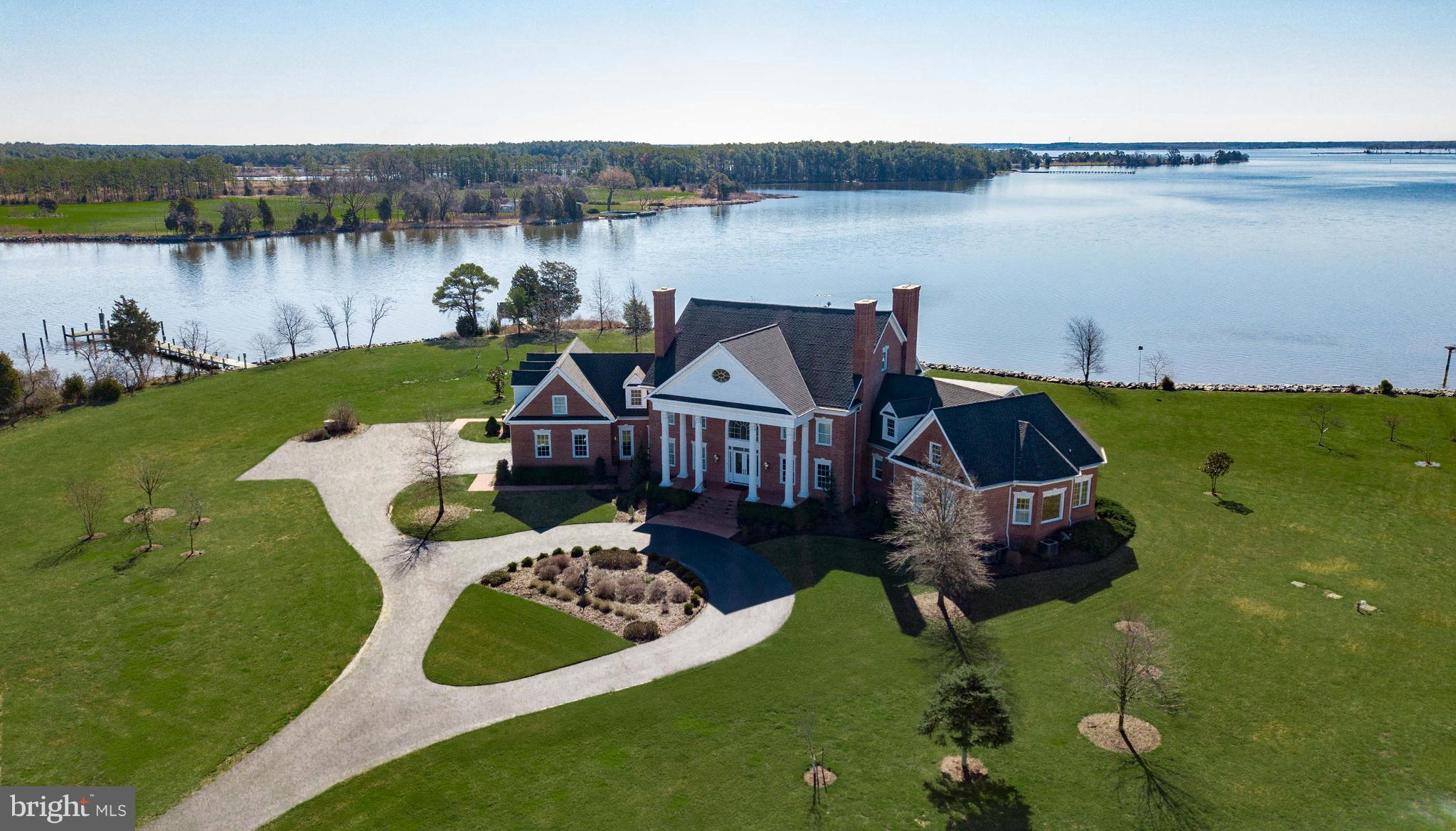 """SOUTHWIND"" A FABULOUS GATED WATERFRONT ESTATE on Maryland's Eastern Shore sits on 214 +/- acres with 2.5+/- miles of waterfront on Hudson Creek. This property features a stunning custom 5 BR brick manor house, 5 BR guest house, barn, workshop, 4 ponds, 2 docks, waterfowl blinds and deer stands. Total of 5 parcels including sweeping lawns, gardens, meadows, farmland, wetlands, and wooded acreage."