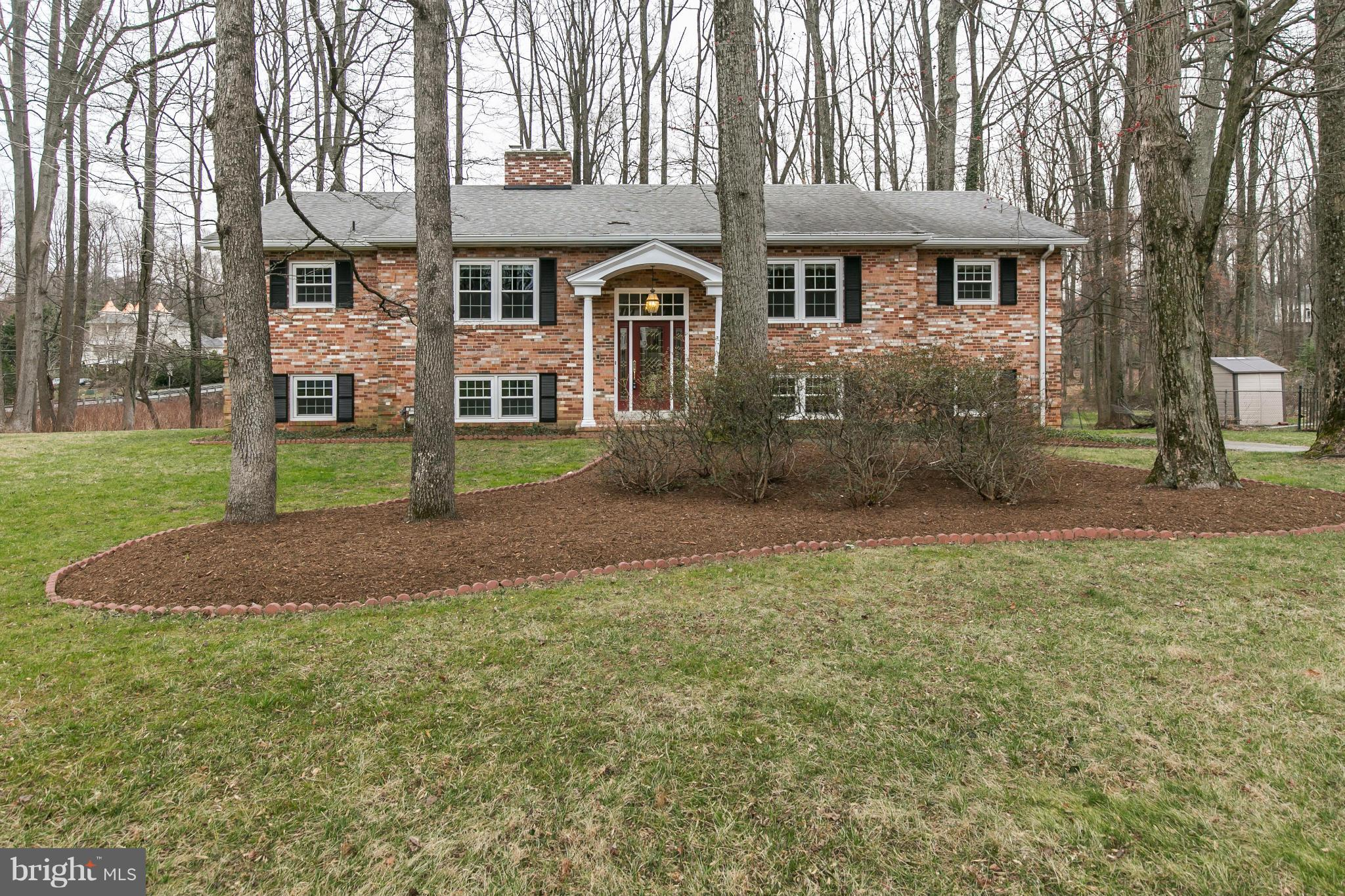 All-brick colonial located on 1+ acre lot - conveniently located to Tysons Corner, DC, Silver Line Metro & two airports.  Two finished levels w/a walk-out LL.  Hardwoods throughout the main level. Updated kitchen w/granite, stainless steel - opens to family room with FP. LR w/FP.  DR w/SGD to deck. LL w/large rec. rm w/FP & 2 addl BRs on the lower level. All BAs are updated. Large, 2-car garage.