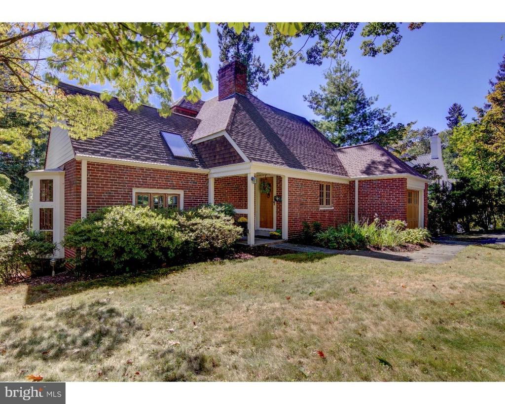 Pre World War II English Cottage in sought after Strafford Village - Neighborhood in Wayne.  Must experience to appreciate the charm throughout in this one of a kind home.  Bring your artistic and creative eyes. great alternative to a townhouse with privacy and yard!  20' cathedral beamed great room with a wood burning  fireplace, open kitchen to dining room, den, powder room,2nd floor 2 bedrooms and bath, 3rd floor 1 bedroom and bath, basement - partial / laundry.  Patio plus deck - Private, sunny backyard.  Steps away to the R-5 train station and the town of Wayne.  T-E schools - All equals a must see!