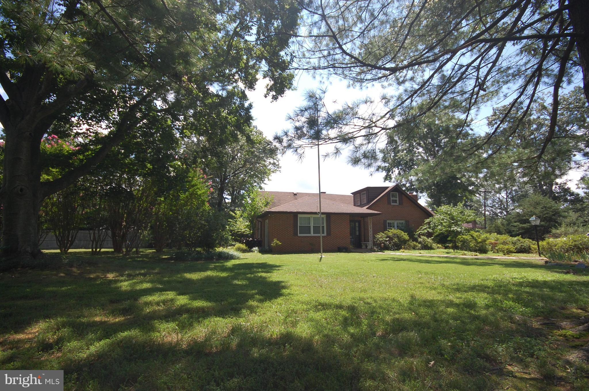 This beautifully  maintained all brick rambler has just been reduced in price.  It's ready for a first-time home buyer or someone who may want to expand and make it their dream home.  The house sits on over a half acre corner lot in a quiet neighborhood.  3 BRs with additional space upstairs (newly carpeted) ideal for workout or home office.  Large LR with brick wood burning fireplace, DR, family/TV room and 4-season room (also newly carpeted).  Utility room and ample storage areas.  Central heat/AC.  Beautiful 20x40 in-ground pool with a new pool motor, picnic area and privacy fencing.  Perfect for entertaining.  Large outdoor custom built 20x10 storage shed.