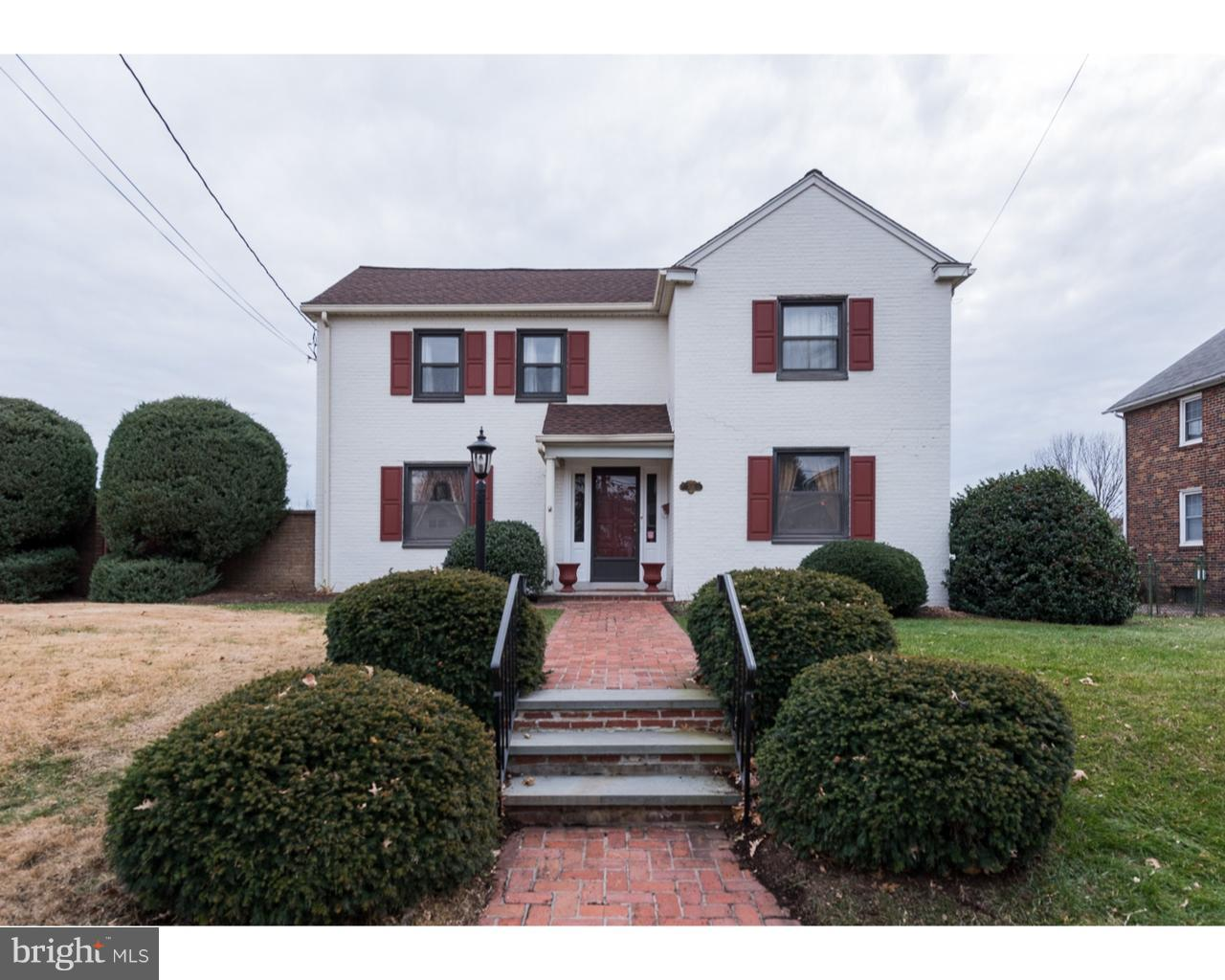 This beautiful brick colonial has 4,300 square feet of elegant living space, over-the-top outdoor amenities, and a lovely residential Wilmington location.  A brick walkway leads to this center-hall Colonial.  Enter to the elegant foyer and main-floor living space with newly refinished hardwood floors throughout.  A picturesque staircase greets you and on one side you'll find the formal living room with bay window, wood-burning fireplace, and custom built-ins.  Across the hall is the formal dining room and spacious kitchen featuring granite countertops and stainless-steel appliances.  The cozy family room has custom built-ins and French doors leading to the 4-season sunroom with a wall of windows overlooking the outdoor entertaining area.  Upstairs, you'll find 3 large bedrooms with beautiful natural light, all with hardwood floors, including the master with en-suite bathroom, and you'll also find an additional bathroom and cedar closet. The lower level of this home includes a fully finished living space including a rec room/family room, a 4th bedroom, a powder room, a large laundry room, and a large cedar closet that could easily be converted to a sauna.  This space has its own outdoor entrance and could be used as an in-law suite or a separate apartment, if needed.  You will be amazed at the 2-tiered outdoor entertaining space on this property.  You'll enjoy a large patio perfect for grilling, outdoor dining, and entertaining.  Then, step down to the lower level with in-ground heated pool, granite wet bar, refrigerator, outdoor shower and bathroom.  All this, surrounded by an 8-foot brick fence for the utmost privacy.  This property includes an oversized attached garage and additional parking.  Many upgrades have been made, including a new roof in 2016, new electric panel, water heater and water pump in 2015, new air conditioning unit and handler in 2016, refinished hardwood floors in 2017, and brand new carpet.   Seller is a licensed real estate agent.  Be sure to