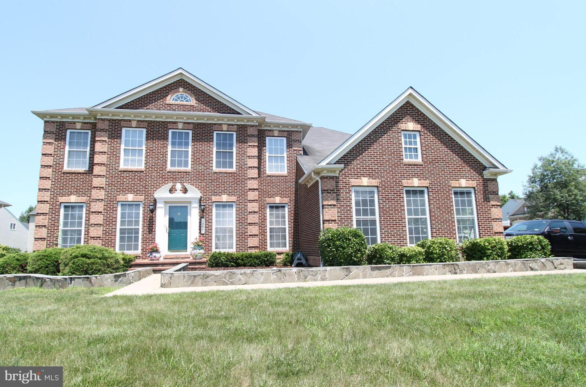 Just reduced! Great deal on this grand brick front colonial w/ side load garage. Welcoming entry w/ formal areas greet you. Cherry hardwoods on upper levels. Gorgeous kitchen w/ all the amenities & large eat-in area opens to family room. Main level guest suite w/ private bath. Huge master suite w/ awesome bath, tray ceiling, sitting area & W/I closet. Finished walkout lower lvl w/ media area, den/office & tons of space + storage.