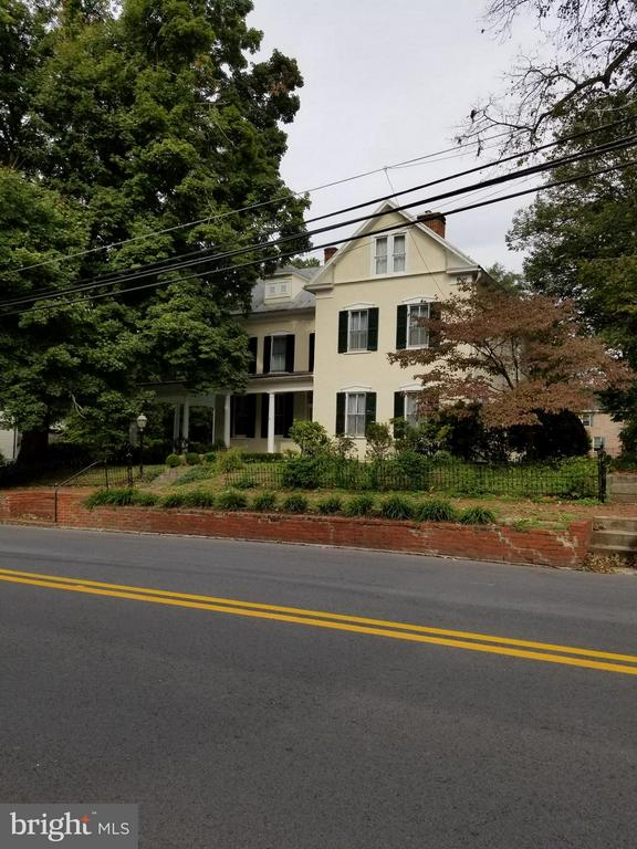 Need a shorter term rental? Fabulous home on the National Historic Registry. Wood floors throughout, large rooms, parking in the rear. Wrap around front porch and rear upper and lower porches.